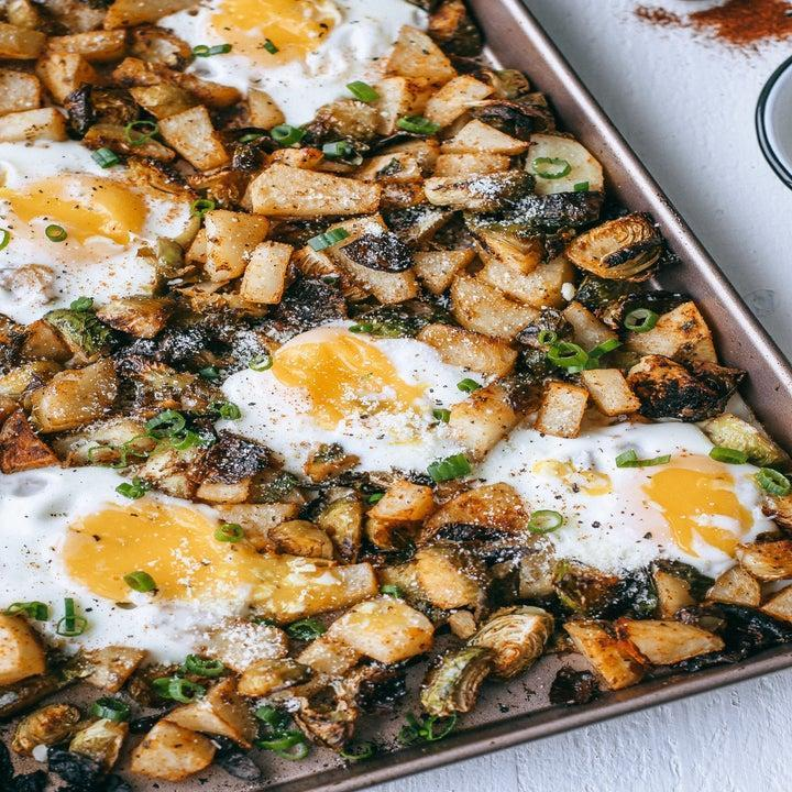 Sheet pan Brussels sprout and potato hash with eggs.