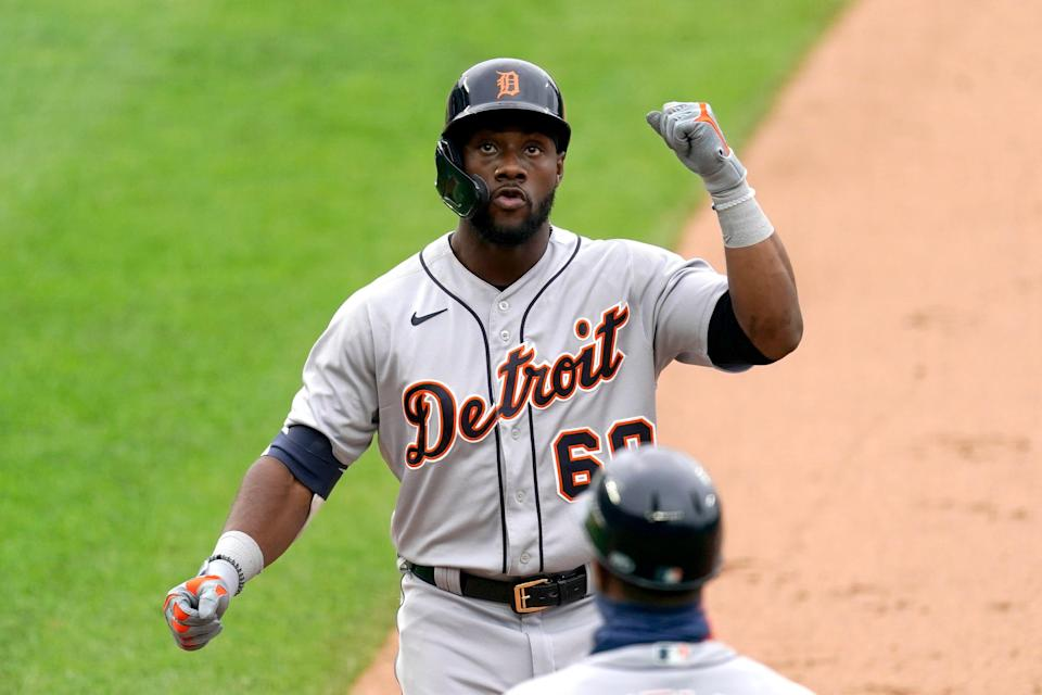 Detroit Tigers' Akil Baddoo celebrates on first after hitting a two-run single during the second inning of a baseball game against the Kansas City Royals Saturday, May 22, 2021, in Kansas City, Missouri.