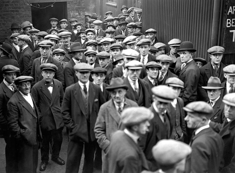 Unemployed men queuing for work