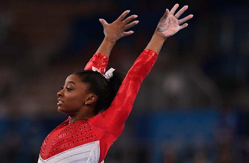 Simone Biles of the United States competes in the vault of the artistic gymnastics women's team final at the Tokyo 2020 Olympic Games in Tokyo, Japan, July 27, 2021. (Photo by Cheng Min/Xinhua via Getty Images)
