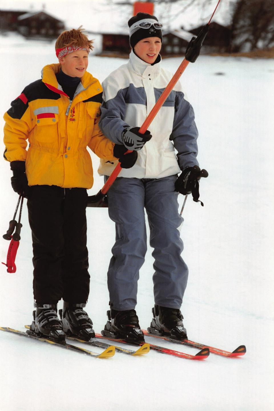 Prince Harry and Zara Phillips hold on to a snow jet ski as they ski on holiday