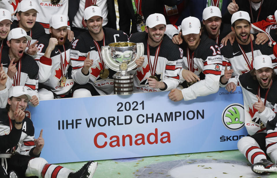 Canada's team players pose with the trophy after winning the Ice Hockey World Championship final match between Finland and Canada at the Arena in Riga, Latvia, Sunday, June 6, 2021. (AP Photo/Sergei Grits)