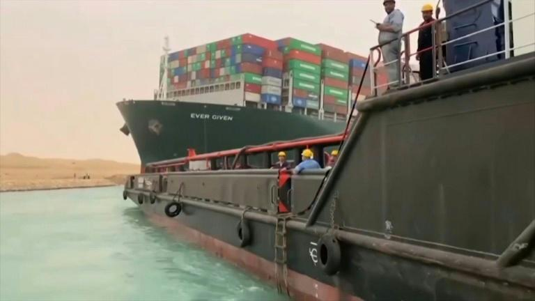 Megaship blocks Suez Canal as workers scramble to refloat grounded vessel