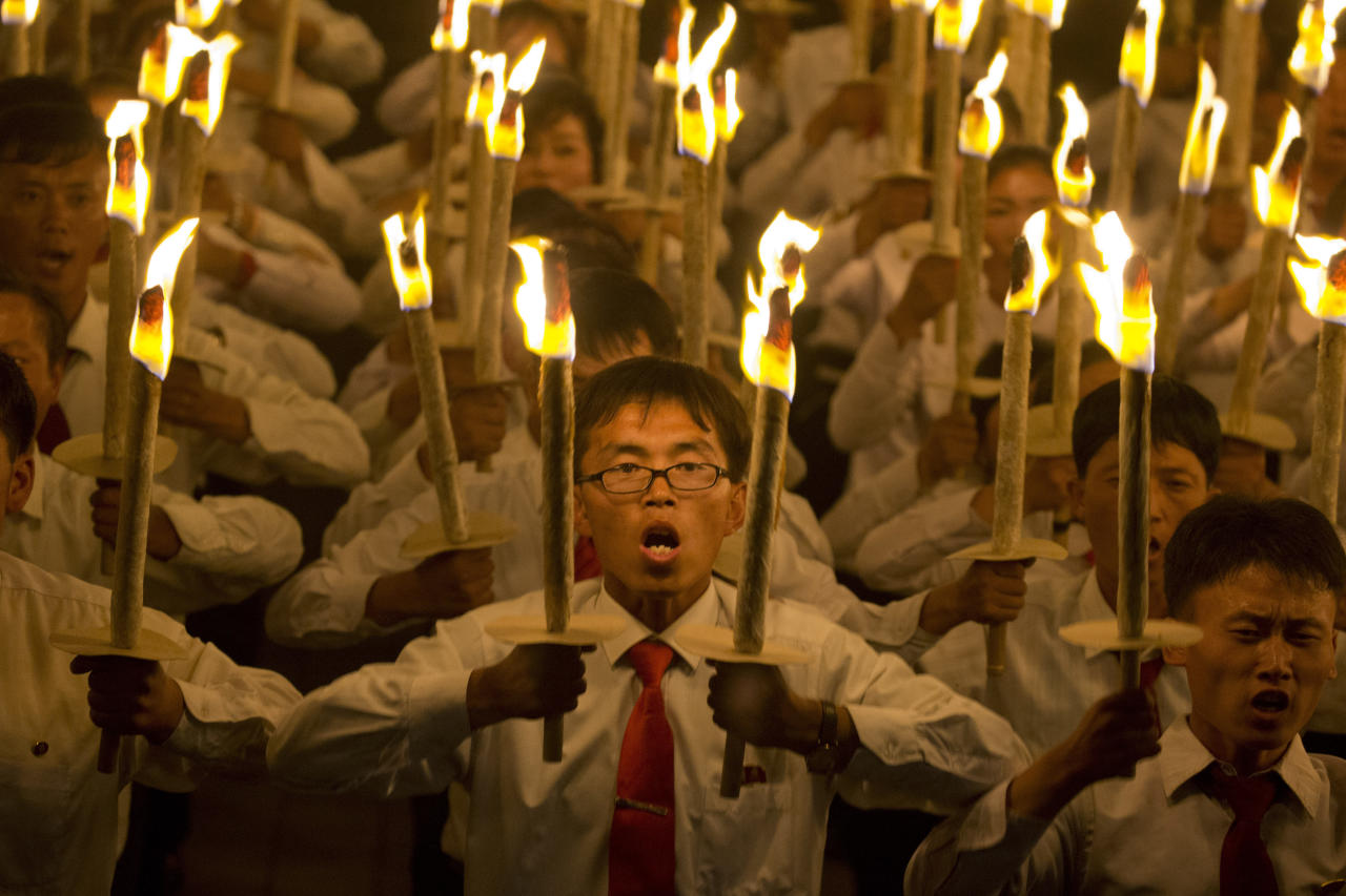 <p>North Korean students take part in a torch light march held in conjunction with the 70th anniversary of North Korea's founding day celebrations in Pyongyang, North Korea, Monday, Sept. 10, 2018. (AP Photo/Ng Han Guan) </p>