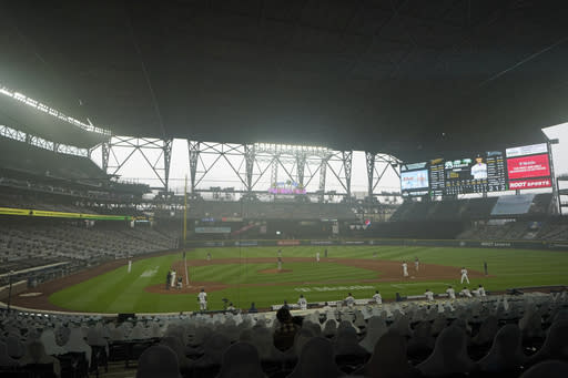 Smoke from wildfires fills the air at T-Mobile Park as the Seattle Mariners and the Oakland Athletics play with the roof extended during the sixth inning of the first baseball game of a doubleheader, Monday, Sept. 14, 2020, in Seattle. The Mariners won 6-5. (AP Photo/Ted S. Warren)
