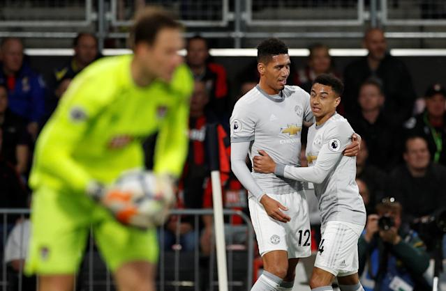 """Soccer Football - Premier League - AFC Bournemouth vs Manchester United - Vitality Stadium, Bournemouth, Britain - April 18, 2018 Manchester United's Chris Smalling celebrates scoring their first goal with Jesse Lingard Action Images via Reuters/John Sibley EDITORIAL USE ONLY. No use with unauthorized audio, video, data, fixture lists, club/league logos or """"live"""" services. Online in-match use limited to 75 images, no video emulation. No use in betting, games or single club/league/player publications. Please contact your account representative for further details."""