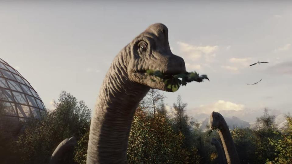 Video game depiction of Apatosauruses eating in a forest while pterodactyls fly in the distance