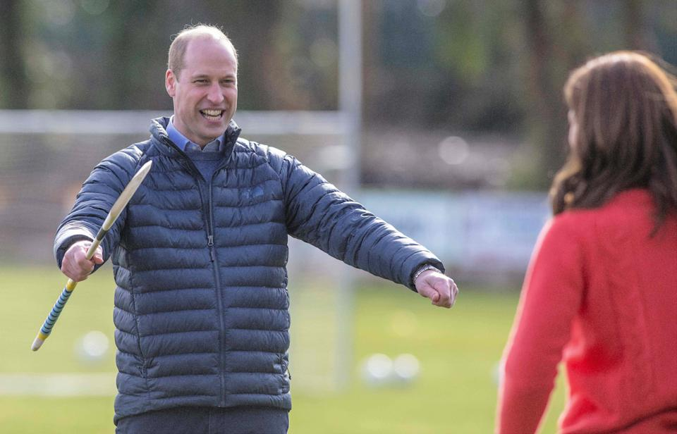 <p>The duke showed he can keep it casual too as he and Kate tried out hurling during a visit to Salthill Gaelic Athletic Association (GAA) club in Galway in March 2020. (Paul Faith / AFP)</p>
