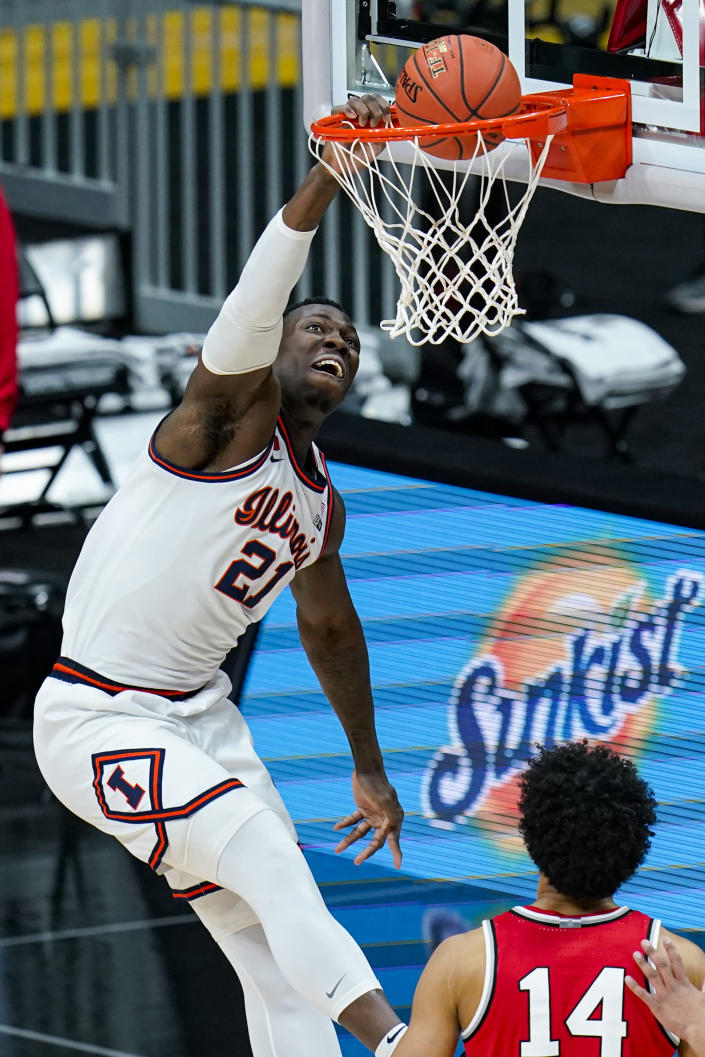 Illinois center Kofi Cockburn (21) goes up for a dunk against Ohio State in an NCAA college basketball championship game at the Big Ten Conference tournament in Indianapolis, Sunday, March 14, 2021. (AP Photo/Michael Conroy)