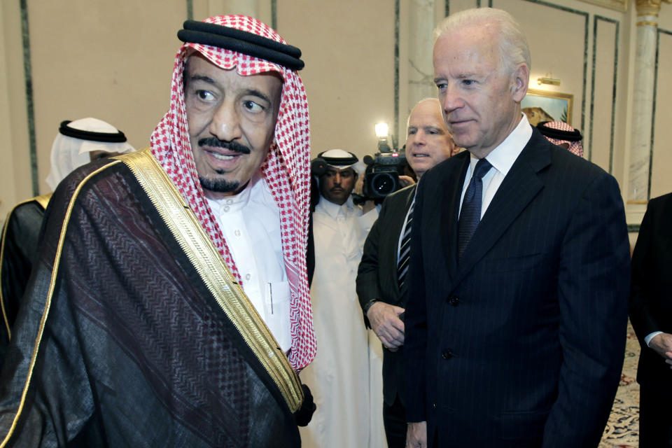 FILE - In this Oct. 27, 2011 file photo, then U.S. Vice President Joe Biden, right, offers his condolences to then Prince Salman bin Abdel-Aziz upon the death of his brother Saudi Crown Prince Sultan bin Abdul-Aziz Al Saud, at Prince Sultan palace in Riyadh, Saudi Arabia. President Joe Biden is expected to speak to Saudi King Salman for the first time in Biden's just over a month-old administration. Coming as soon as Thursday, the conversation between the two strategic partners will be overshadowed by the expected release of U.S. intelligence findings on whether the king's son approved the killing of a U.S.-based Saudi journalist. (AP Photo/Hassan Ammar)