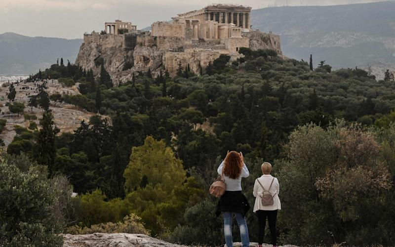 Tourist sites in Greece such as the Acropolis have recently reopened as the nation eases its lockdown - LOUISA GOULIAMAKI/AFP