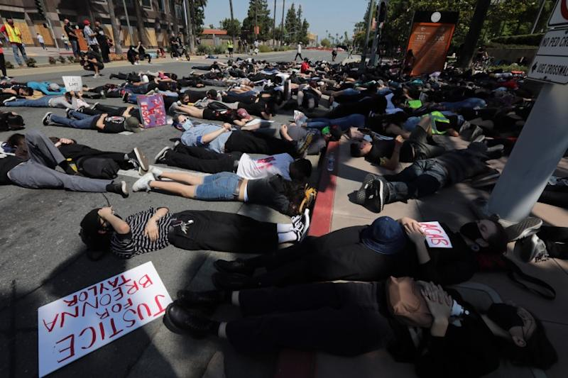 ANAHEIM CA. JUNE 3, 2020 - A group of demonstrators stage a sit-in in front of the Anaheim Civic Center Wednesday, June 3, 2020, to protest the in-custody death of George Floyd. (Irfan Khan / Los Angeles Times)