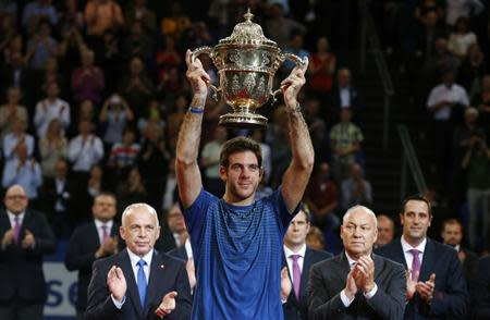 Del Potro of Argentina raises the winner's trophy after he won his final match against Switzerland's Federer at the Swiss Indoors ATP tennis tournament in Basel