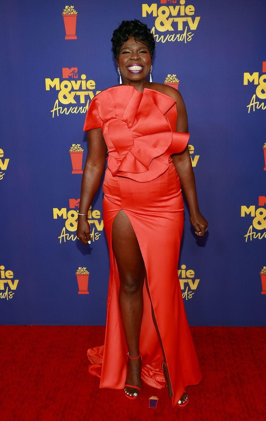 <p>Leslie Jones – who was presenting the award show, so went through a few fun looks – started out the evening in a colourful red gown with a floral motif.</p>