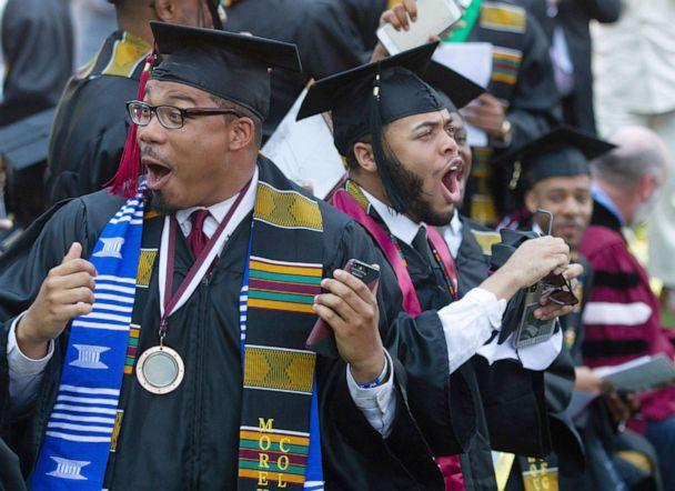 PHOTO: Graduates react after hearing billionaire technology investor and philanthropist Robert F. Smith say he will provide grants to wipe out the student debt of the entire 2019 graduating class at Morehouse College in Atlanta, May 19, 2019. (Steve Schaefer/Atlanta Journal-Constitution via AP)