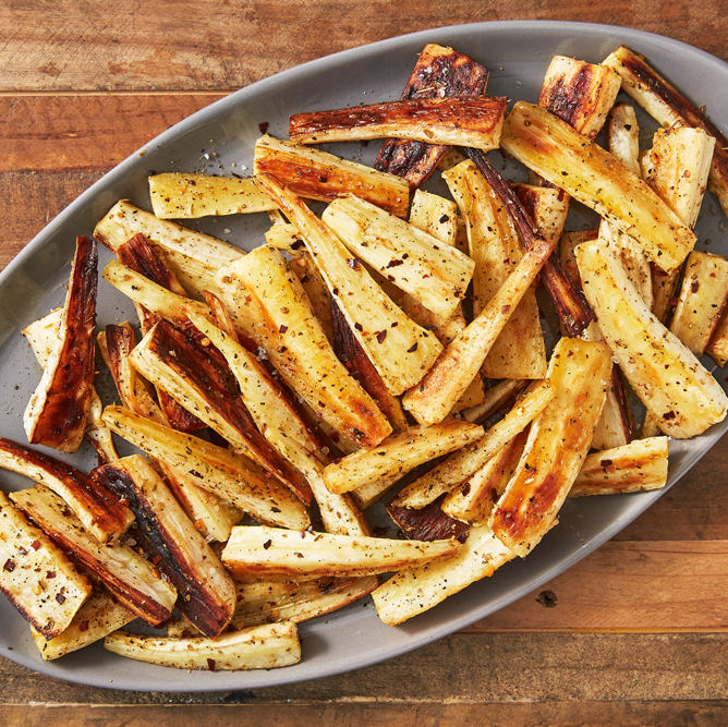 """<p>Roasting them makes them slightly sweet and perfectly tender for a quick side dish you might love more than the main course.</p><p>Get the <a href=""""https://www.delish.com/uk/cooking/recipes/a29871209/roast-parsnips-recipe/"""" rel=""""nofollow noopener"""" target=""""_blank"""" data-ylk=""""slk:Roasted Parsnips"""" class=""""link rapid-noclick-resp"""">Roasted Parsnips</a> recipe.</p>"""