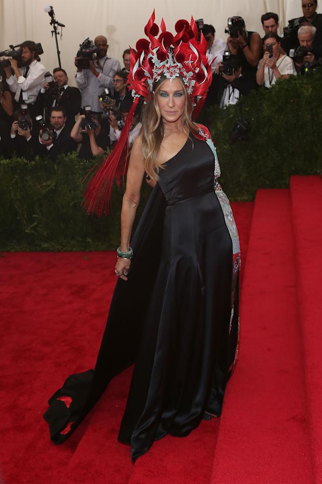 <p>The fashion icon paired a H&M (seriously) dress with the flame-flanked headpiece. <em>[Photo: Getty]</em> </p>