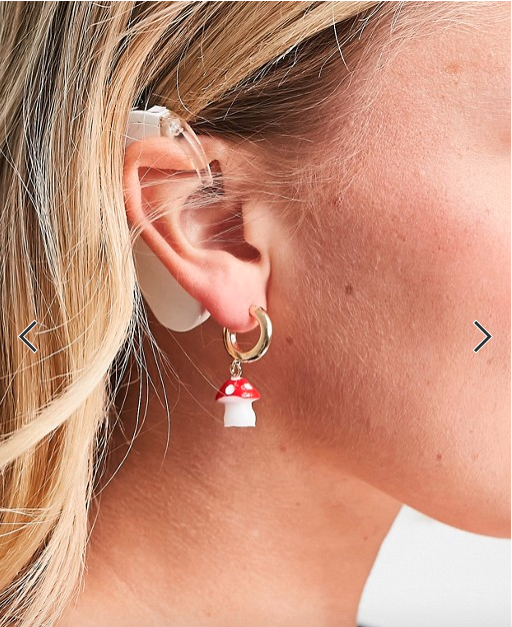 Woman with a hearing aid ad on ASOS
