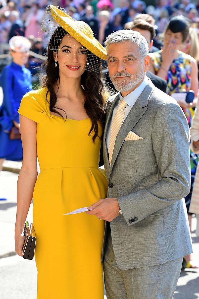 Amal and George Clooney arrive at St George's Chapel at Windsor Castle before the wedding of Prince Harry to Meghan Markle on May 19, 2018 in Windsor, England.