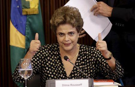 Brazil's President Dilma Rousseff gestures during a meeting with union members and businessmen in Brasilia
