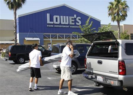 People load a roll of carpet into a vehicle at the Lowe's Home Improvement Warehouse in Burbank, California August 15, 2011. REUTERS/Fred Prouser