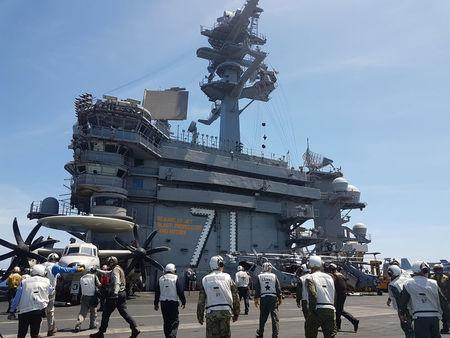 A busy day on the flight deck of the USS Theodore Roosevelt while transiting the South China Sea April 10, 2018. REUTERS/Karen Lema