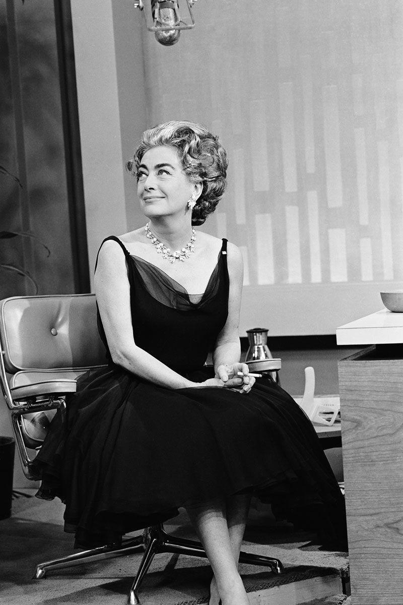 <p>Joan Crawford opted for a tulle scoop neck black dress when she appeared on <em>The Tonight Show</em> starring Johnny Carson. </p>