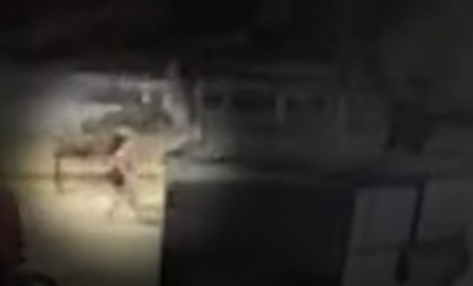 CCTV shows a woman walking out of a bar with a man in Deep Ellum, Dallas.