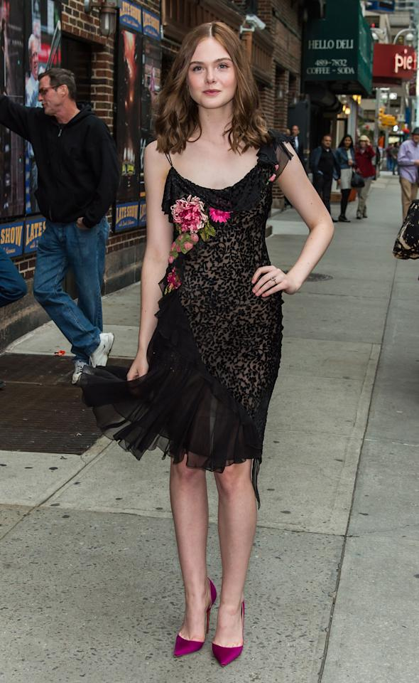 <p>Wearing a black dress with floral detailing while leaving a taping of<em> The Late Show with David Letterman</em>. </p>