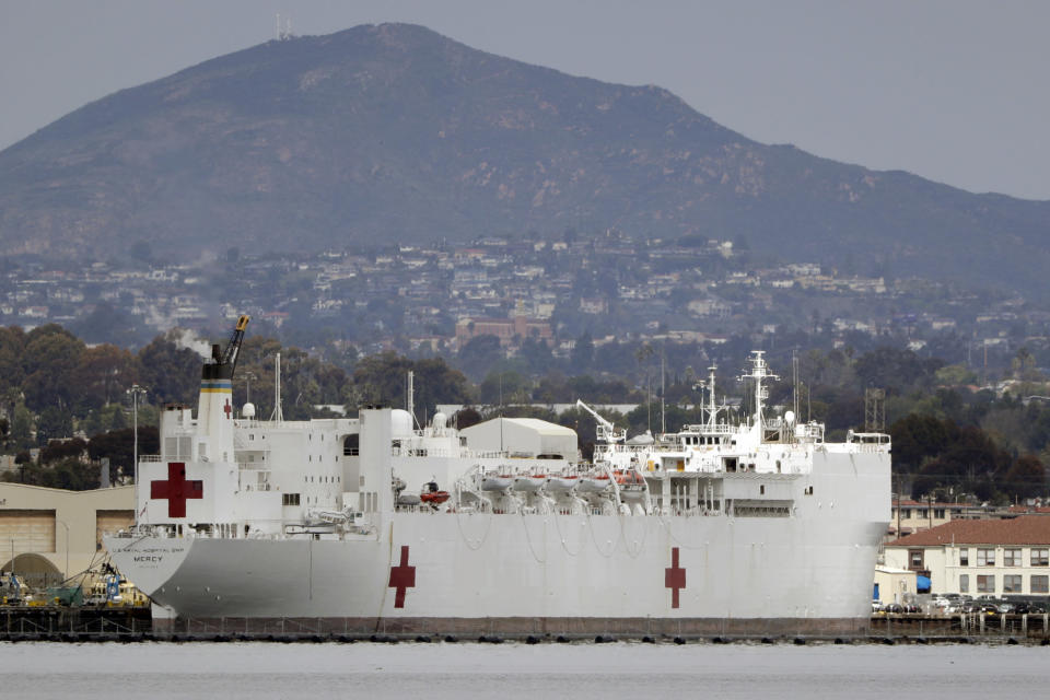 FILE - In this Wednesday, March 18, 2020, file photo, The USNS Mercy, a Navy hospital ship is seen docked at Naval Base San Diego in San Diego, Calif. To help combat an expected shortage of hospital beds as the virus spreads, the U.S. Naval hospital ship Mercy departed San Diego on Monday, March 23, bound for Los Angeles to treat non-coronavirus patients. The 1,000-bed USNS Mercy is expected to arrive in less than a week and begin accepting patients within a day of arrival, Capt. John R. Rotruck said. (AP Photo/Gregory Bull, File)