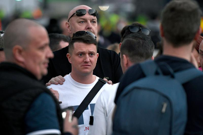 WHITEHALL, LONDON, GREATER LONDON, UNITED KINGDOM - 2019/03/29: The right-wing leader Tommy Robinson (center), whose real name is Stephen Yaxley-Lennon seen leaving the Make Brexit Happen stage in Whitehall after addressed a speech to his supporters. A Leave means leave pro Brexit march began on March 16 in Sunderland, UK and ended with a rally in Parliament Square on March 29 in London, same day that UK has been scheduled to leave the European Union. Pro Brexit protesters gathered at Parliament Square to demand the government deliver what was promised and leave the European Union without a deal. Nigel Farage and Tommy Robinson were seen giving speeches to their supporters in different stages during the pro Brexit protest. (Photo by Andres Pantoja/SOPA Images/LightRocket via Getty Images)