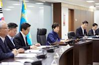 South Korean President Park Geun-hye (3rd R) presides over the National Security Council at the Presidential Blue House in Seoul, South Korea, in this handout picture provided by the Presidential Blue House and released by Yonhap on February 7, 2016. REUTERS/Presidential Blue House/Yonhap