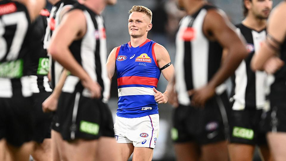 Adam Treloar, pictured here celebrating after the Western Bulldogs beat Collingwood.