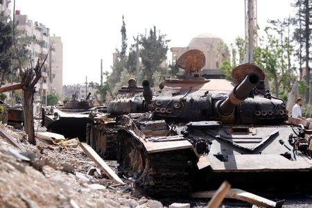 A damaged military vehicle is seen at the city of Douma in Damascus