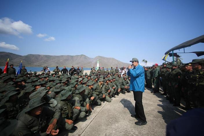 Venezuela's President Nicolas Maduro speaks to troops at a naval base, a day after a top general sided with the opposition (AFP Photo/Marcelo GARCIA)