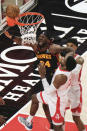 Atlanta Hawks forward Bruno Fernando (24) reacts to missing a shot against the Houston Rockets during the first half of an NBA basketball game on Sunday, May 16, 2021, in Atlanta. (AP Photo/Ben Gray)