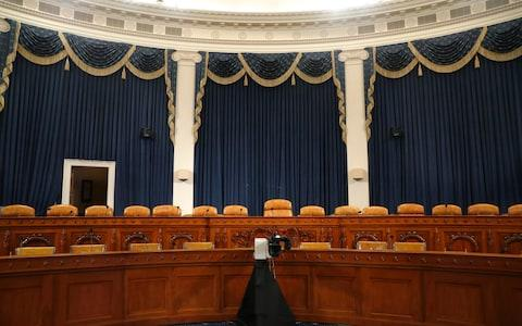 The dais in the hearing room where the House will begin public impeachment inquiry hearings - Credit: AP