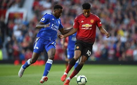 Leicester City's Nigerian midfielder Wilfred Ndidi (L) vies with Manchester United's English striker Marcus Rashford during the English Premier League football match between Manchester United and Leicester City at Old Trafford in Manchester, north west England, on August 10, 2018 - Credit: AFP