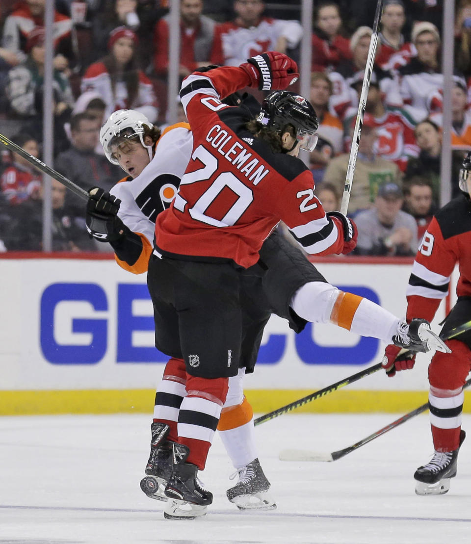 Philadelphia Flyers' Joel Farabee, left, and New Jersey Devils' Blake Coleman collide during the second period of an NHL hockey game in Newark, N.J., Friday, Nov. 1, 2019. (AP Photo/Seth Wenig)
