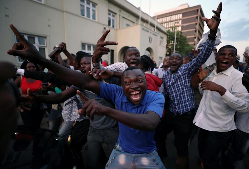 Zimbabweans celebrate in the capital city of Harare after President Robert Mugabe resigned on Nov. 21.
