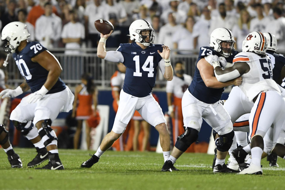 Penn State quarterback Sean Clifford (14) passes during an NCAA college football game against Auburn in State College, Pa., on Saturday, Sept. 18, 2021. (AP Photo/Barry Reeger)