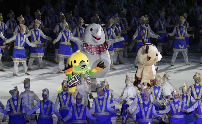 The official games mascots during the opening ceremony for the 18th Asian Games in the Gelora Bung Karno Stadium, Jakarta, Indonesia, Saturday, Aug. 18, 2018. (AP Photo/Lee Jin-man)