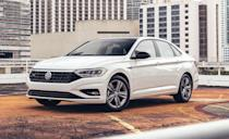 """<p>The <a href=""""https://www.caranddriver.com/volkswagen/jetta"""" rel=""""nofollow noopener"""" target=""""_blank"""" data-ylk=""""slk:Volkswagen Jetta"""" class=""""link rapid-noclick-resp"""">Volkswagen Jetta</a> is consistently popular with buyers looking for upscale style and features on a budget. The compact four-door has base price below $20,000 and there are many models to choose from, all featuring turbocharged engines and well-equipped cabins. For 2020 every Jetta gets the latest version of VW's infotainment system, which includes a subscription-based Wi-Fi hotspot. The SE and R-Line models now offer a heated steering wheel and heated rear seats, while the top-tier SEL and SEL Premium get standard wireless smartphone charging.</p><p>Most models are powered by a responsive 147-hp turbocharged 1.4-liter four-cylinder, while the sportiest of the bunch, the Jetta GLI, which found a spot on out 10Best list, gets the 228-hp turbocharged 2.0-liter four-cylinder and seven-speed dual-clutch automatic from the Golf GTI. A six-speed manual is also available. Fuel economy ratings with the base engine and the eight-speed automatic are impressive at 30 mpg in the city and 40 mpg highway.</p>"""