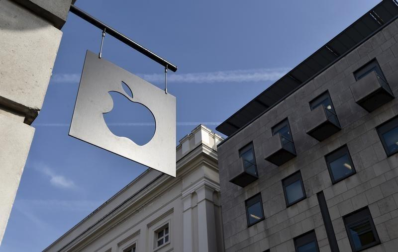 A sign is seen outside the Apple Store in Covent Garden in London