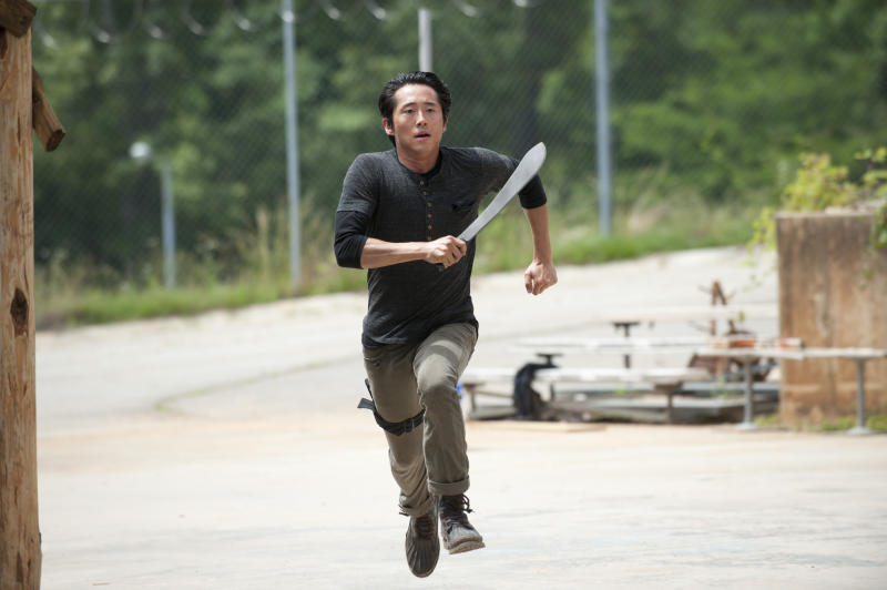 "This image released by AMC shows Steven Yeun as Glenn in a scene from ""The Walking Dead,"" premiering Oct. 13 at 9 p.m. EST. (AP Photo/AMC, Gene Page)"