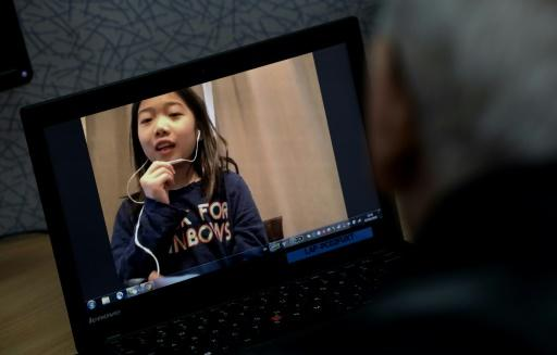 Charlotte Qiu is doing online lessons from her home in Shanghai while schools are shuttered due to the coronavirus outbreak