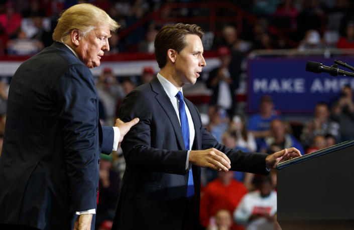 President Trump escorts Republican Senate candidate Josh Hawley to the podium during the rally. (Photo: Carolyn Kaster/AP)