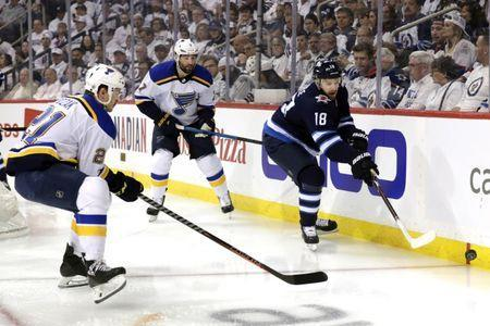 FILE PHOTO: Apr 18, 2019; Winnipeg, Manitoba, CAN; Winnipeg Jets center Bryan Little (18) and St. Louis Blues center Tyler Bozak (21) chase down the puck in the first period in game five of the first round of the 2019 Stanley Cup Playoffs at Bell MTS Place. Mandatory Credit: James Carey Lauder-USA TODAY Sports