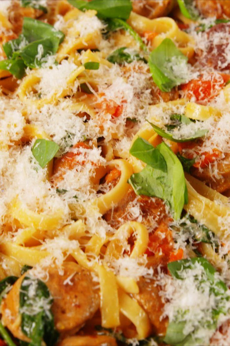 """<p>Pasta is forever and always a comfort food. Use any combo of pasta, sauce, and leftovers, grate some cheese over the top, and say """"DINNER!"""" </p><p>Get the recipe from <a href=""""https://www.delish.com/cooking/recipe-ideas/recipes/a51973/creamy-tuscan-sausage-pasta-recipe/"""" rel=""""nofollow noopener"""" target=""""_blank"""" data-ylk=""""slk:Delish."""" class=""""link rapid-noclick-resp"""">Delish.</a></p>"""