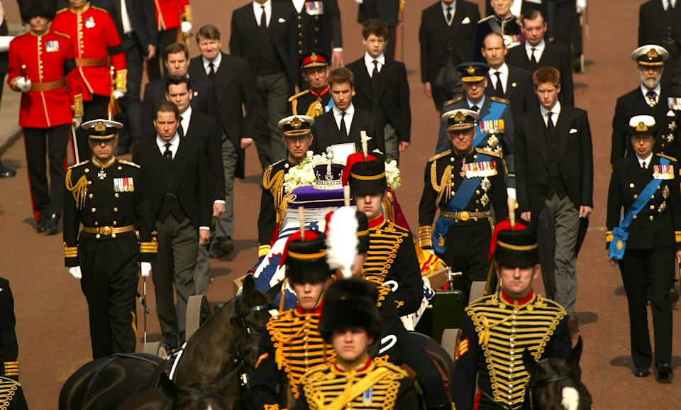 403363 01: Prince Charles (C) with other members of the British Royal Family walk behind a coffin bearing the Queen Mother April 5, 2002 as her ceremonial procession makes its way down The Mall in London. The Queen Mother's body will lie in state in Westminster Hall before her funeral in four days. (Photo by Sion Touhig/Getty Images)